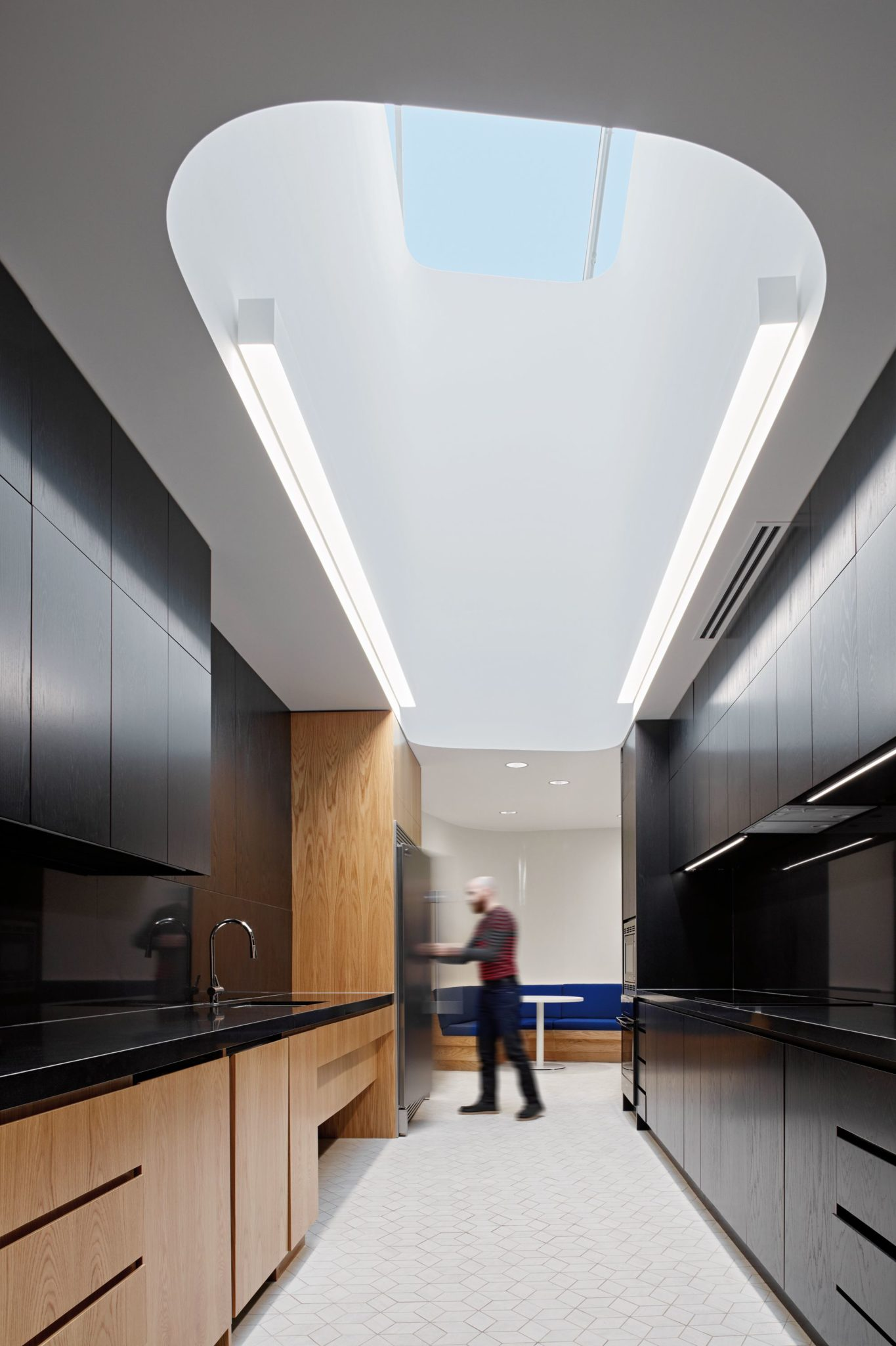Office kitchen with ceiling inspired by the ice rink
