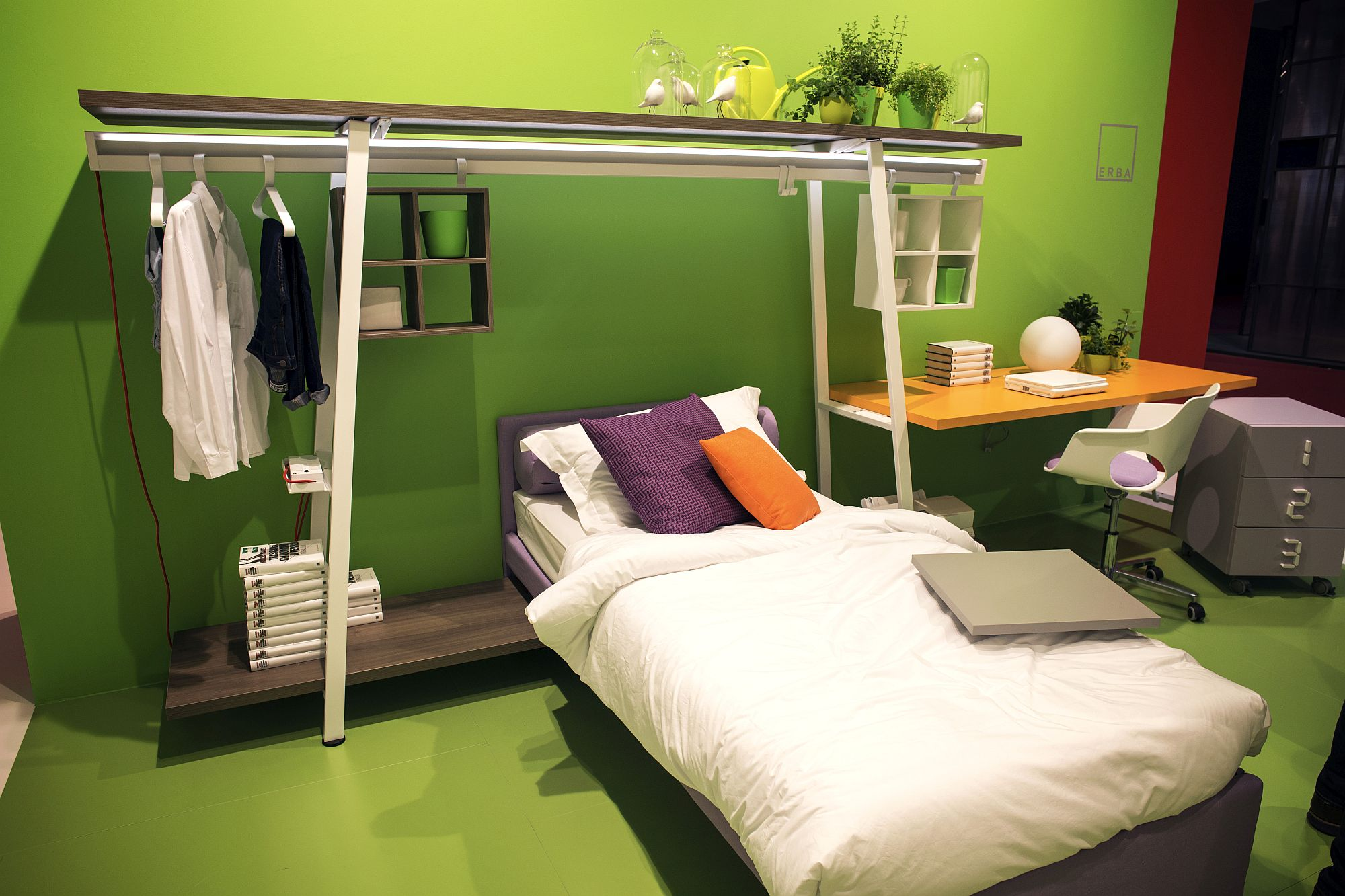 Open hanger system above the bed is a smart space-saver for the small bedroom