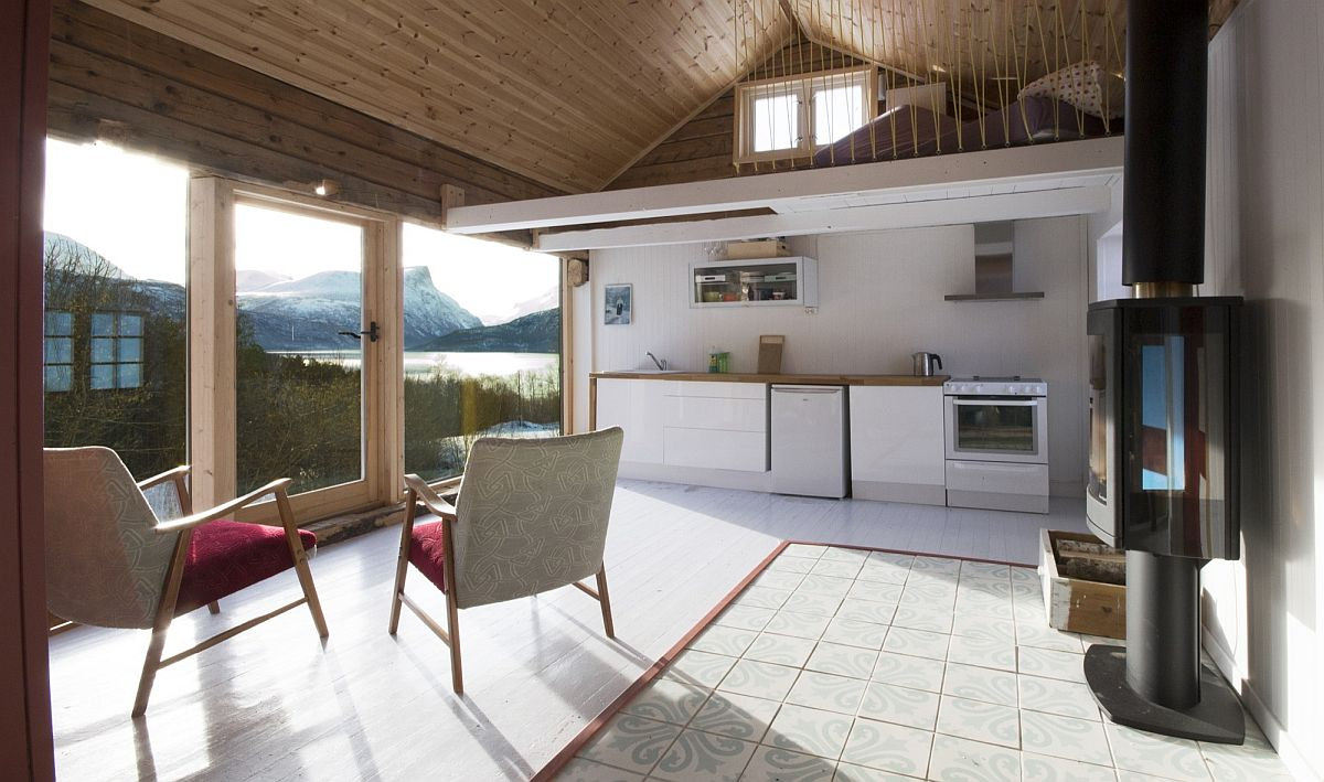 Open living area with large window offers a view of the spectacular fjords