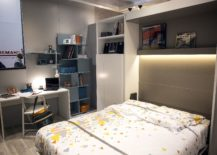 Open-shelves-are-coupled-with-work-station-and-corner-wardrobe-in-this-modern-tween-room-217x155