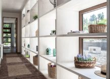 Open-shelves-offer-ample-display-space-in-the-hallway-217x155