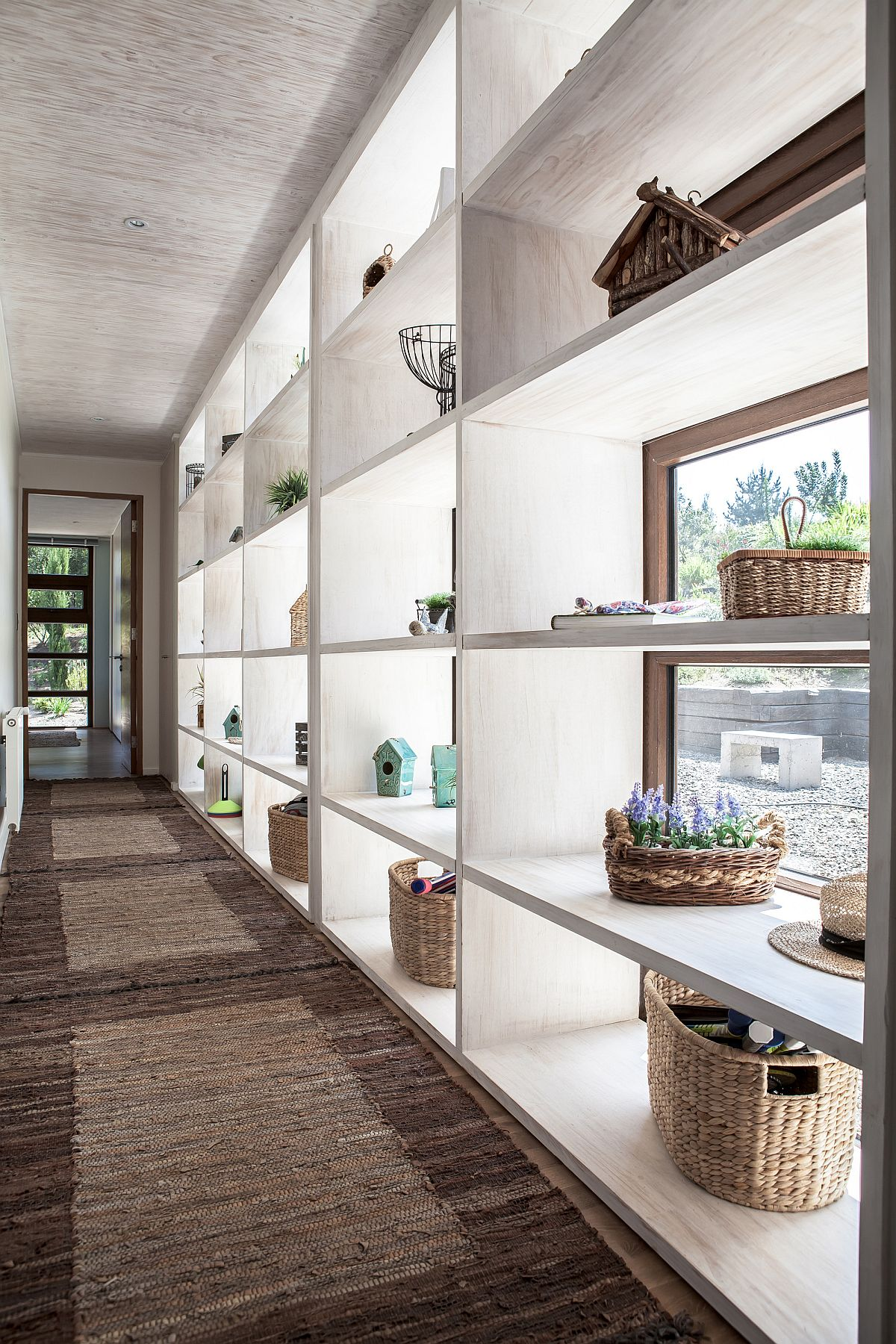 Open shelves offer ample display space in the hallway