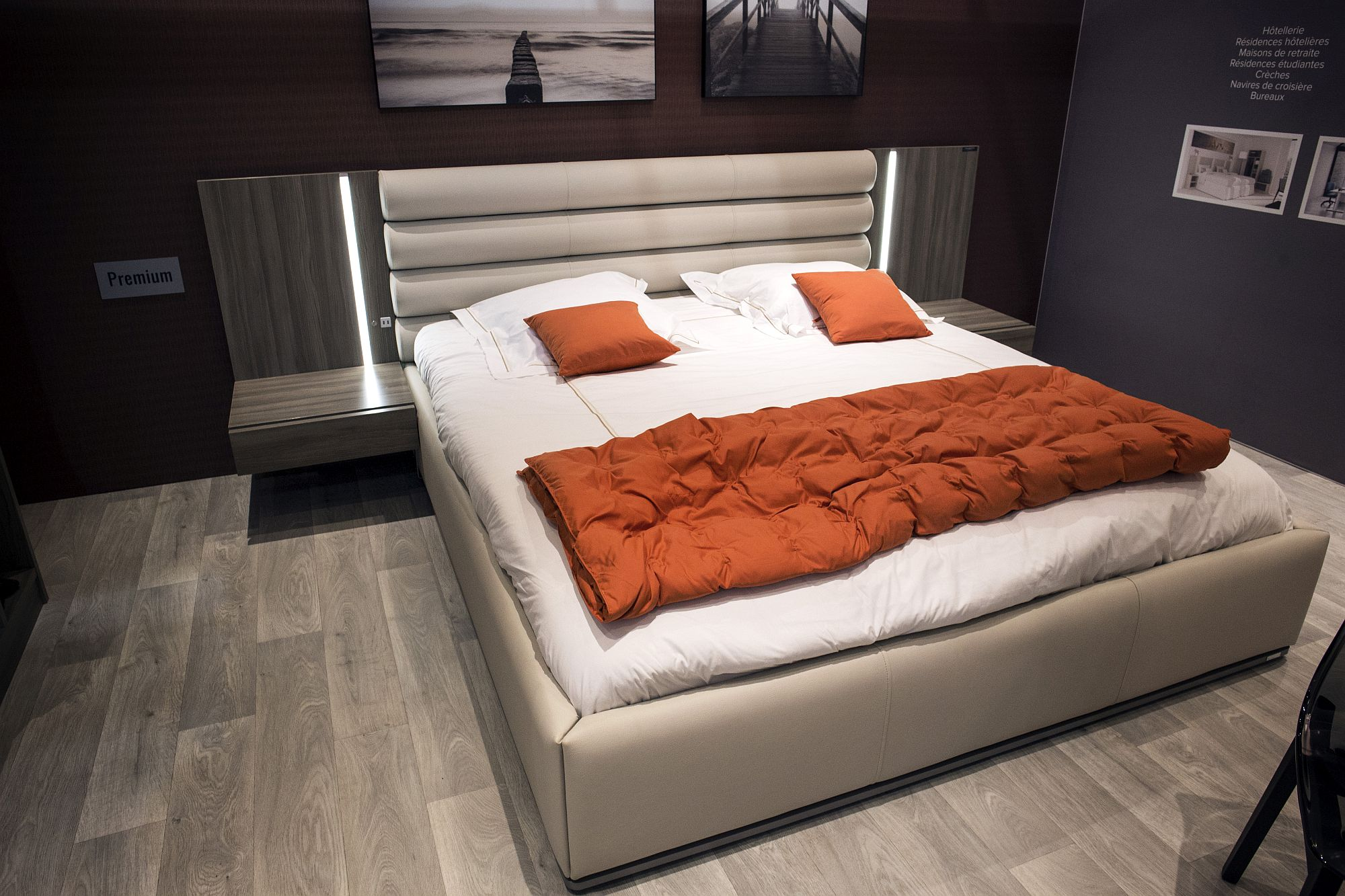 Orange quilt and accent pillows for the neutral bedroom in white and gray