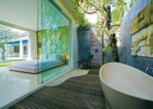 Organic-outdoor-shower-with-beautiful-wooden-flooring-217x155