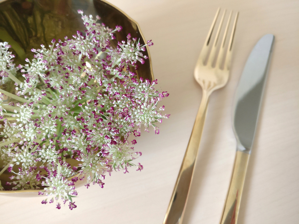 Place flowers in a brass bowl