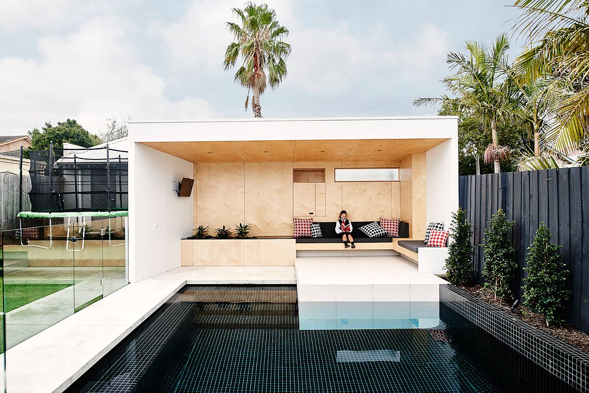 Plywood clad bunker at the end of the pool
