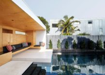 Plywood-gives-the-hangout-next-to-the-pool-a-warm-and-cozy-appeal-217x155