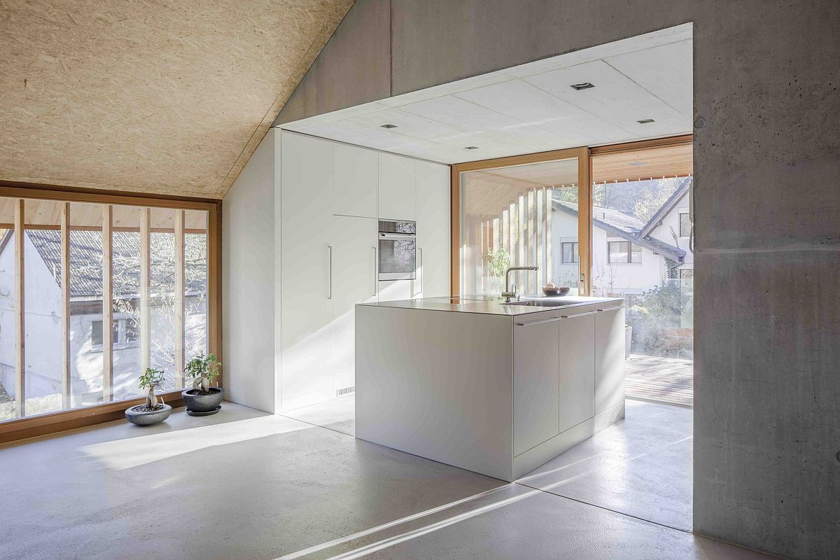 Polished-living-room-and-kitchen-with-ample-natural-light