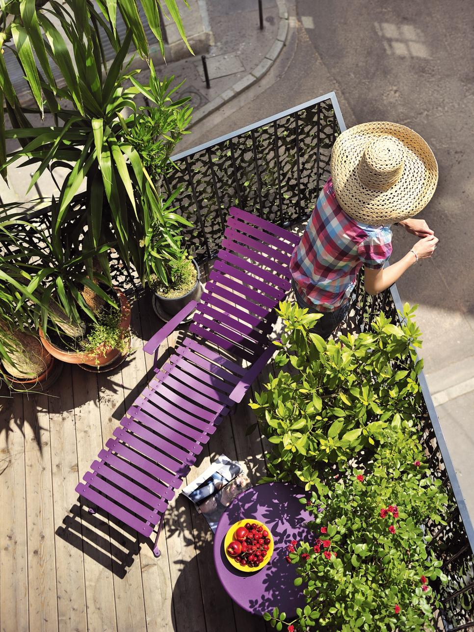 Purple balcony as a modern oasis within a busy city