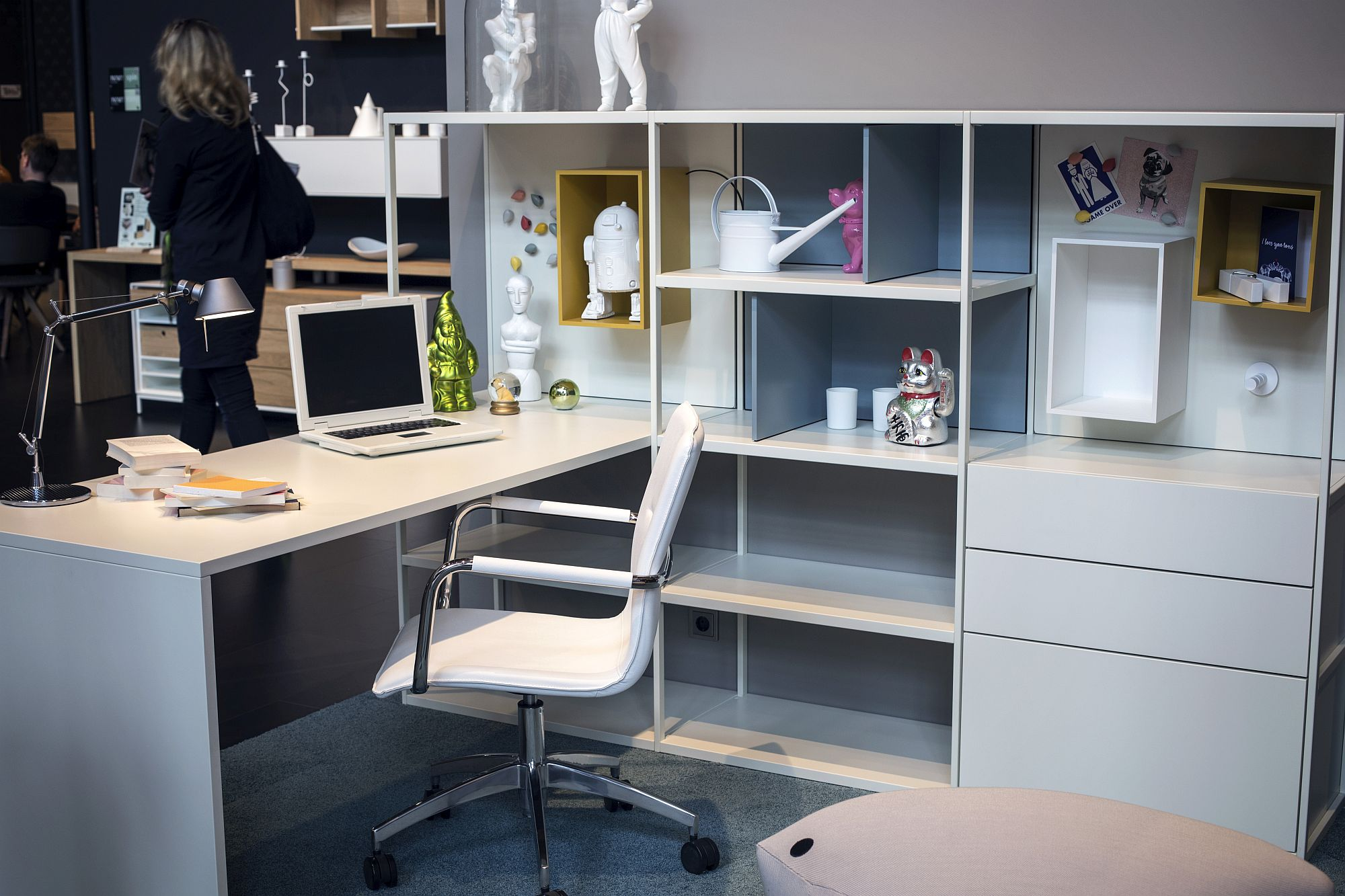 Quirky accessories used to decorate the home office shelf