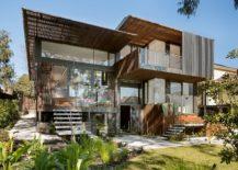 Rear-facade-of-the-home-opens-up-towards-the-garden-217x155