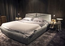 Round-bedside-tables-with-pendants-above-and-a-low-slung-bed-217x155
