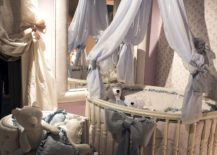 Round-crib-with-a-canopy-above-allows-the-nursery-to-stand-out-from-the-usual-217x155