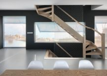 Sculptural-wooden-staircase-and-minimal-interior-of-the-modern-Dutch-home-217x155