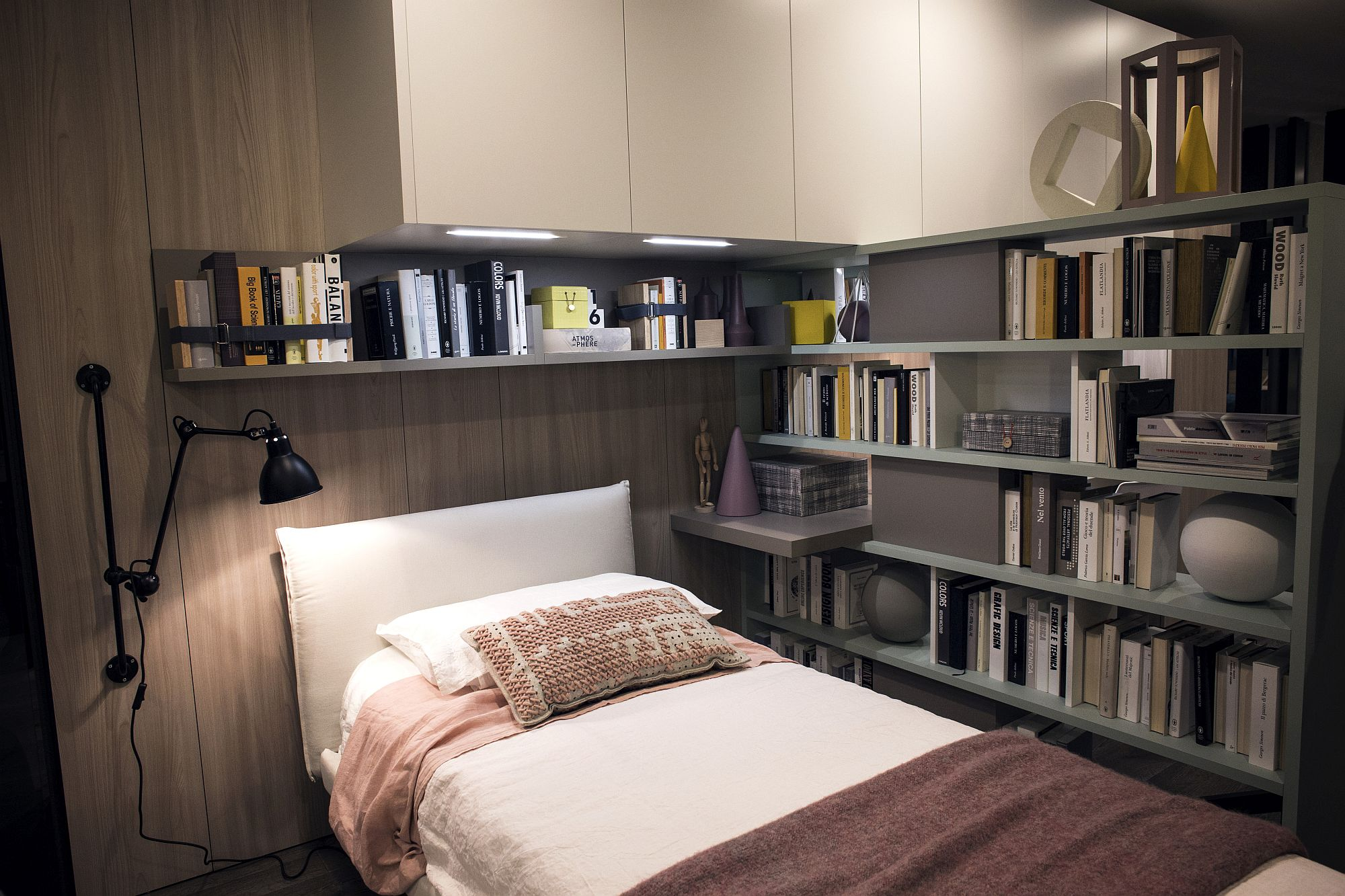 Series of open shelves around the bed helps stack all those books and toys