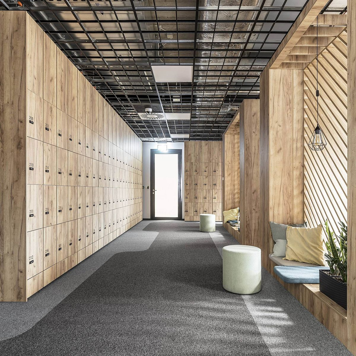 Series of wooden lockers at the entrance of the Poznan office space