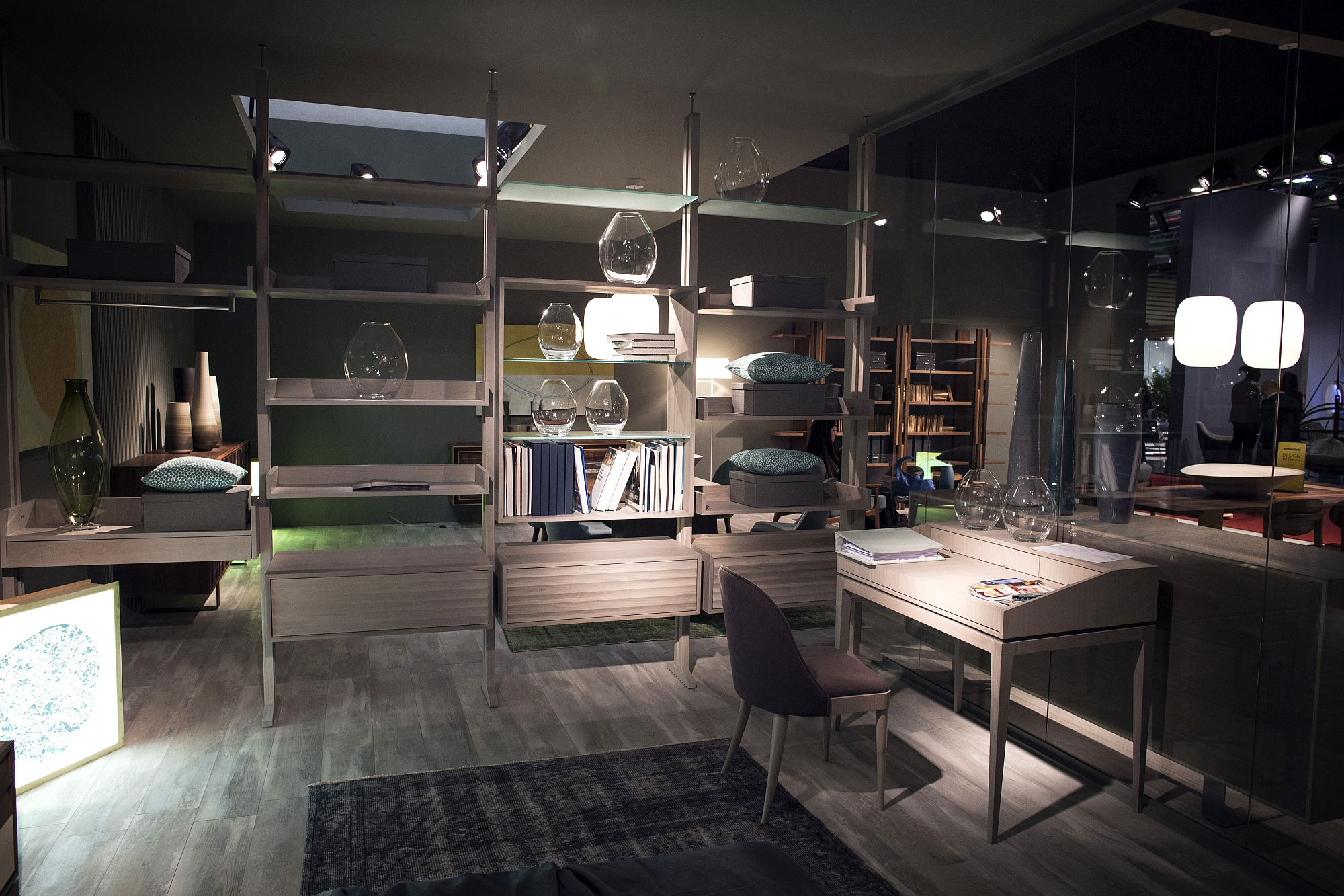 Shelves-act-as-room-dividers-while-the-desk-provides-a-space-savvy-workspace