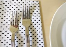 Silver-flatware-on-a-speckled-napkin-217x155