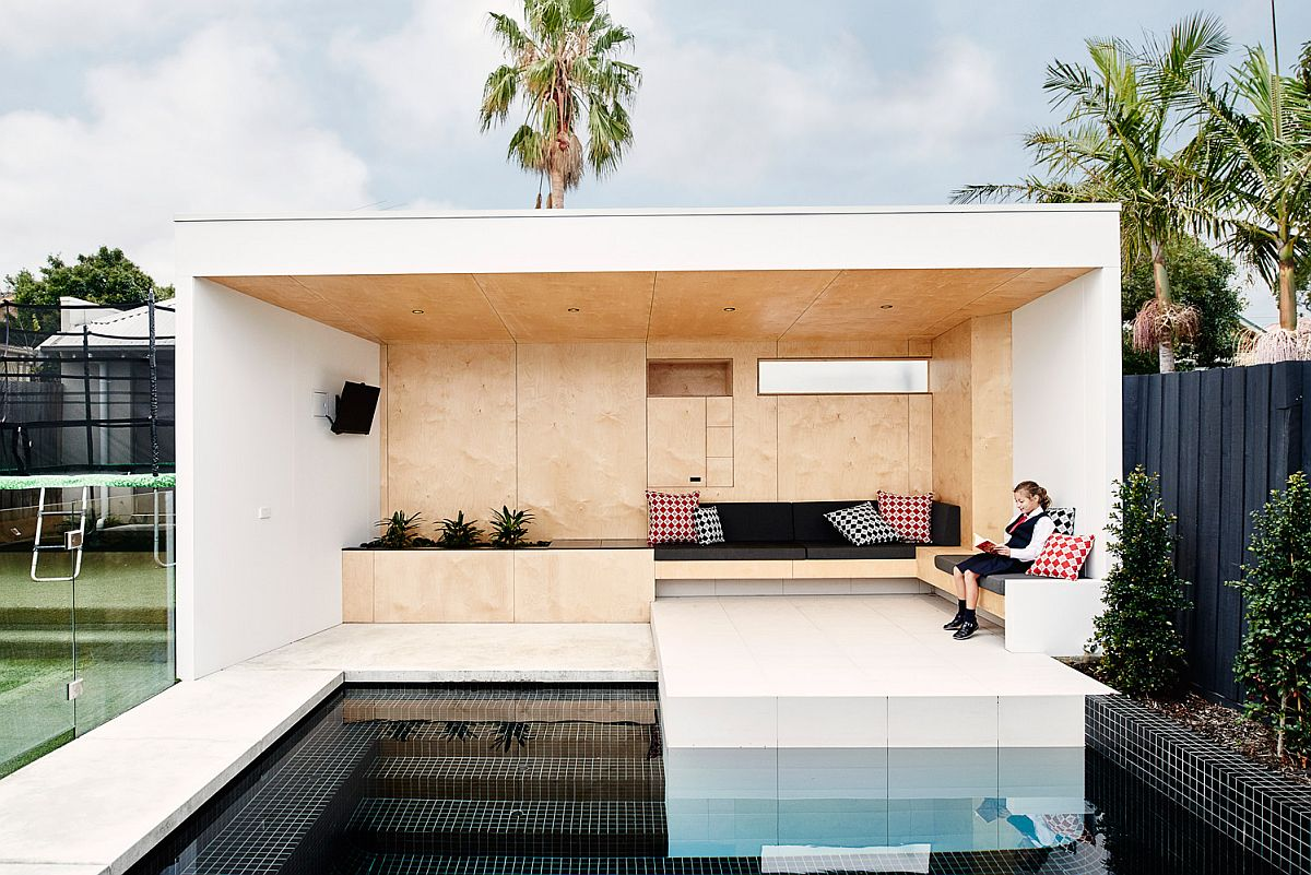 Simple and elegant seating for the bunker Brighton Bunker: This Plywood Clad Poolside Hangout Does it All!