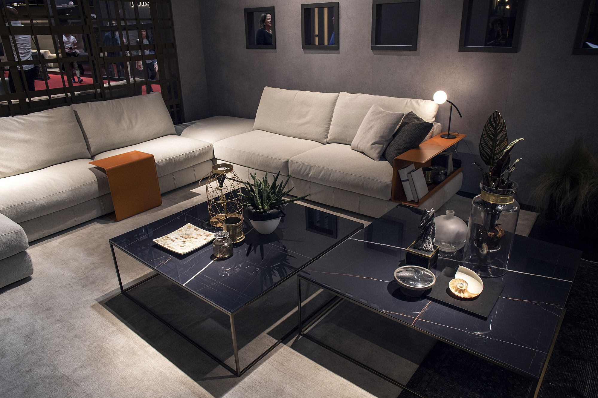 Simple orange additions at the end of the couch hold drinks while offering display space