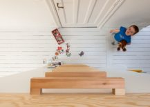 Simple-wooden-ladder-leads-to-the-loft-play-area-above-the-beds-217x155