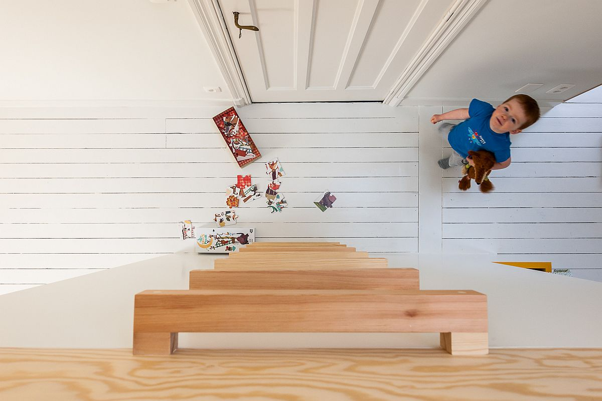 Simple wooden ladder leads to the loft play area above the beds