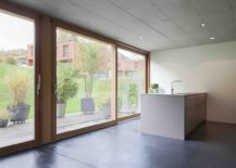 Sliding-glass-doors-with-wooden-frame-bring-in-natural-light-217x155