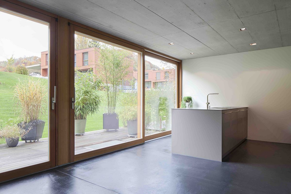 Sliding glass doors with wooden frame bring in natural light
