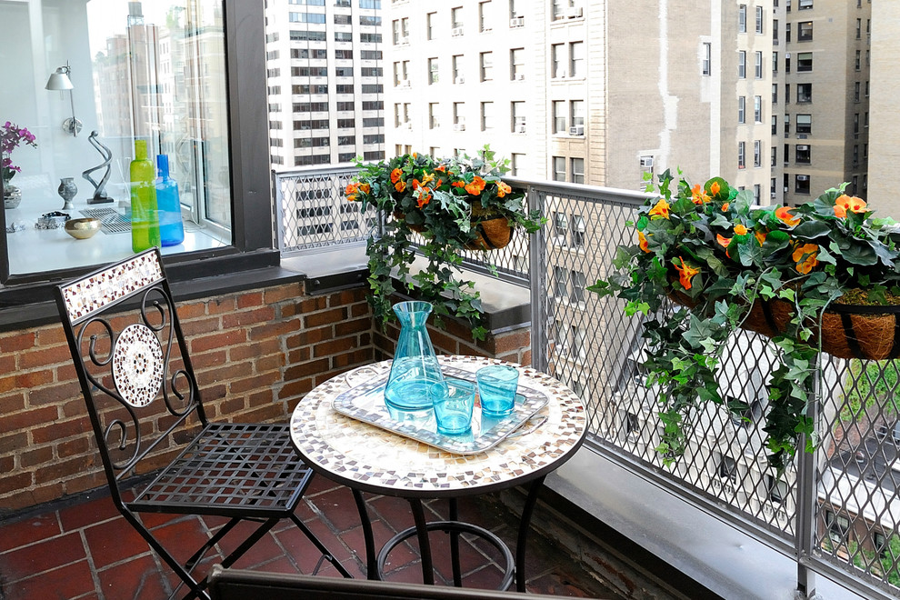 Small industrial balcony with temporary colorful pieces