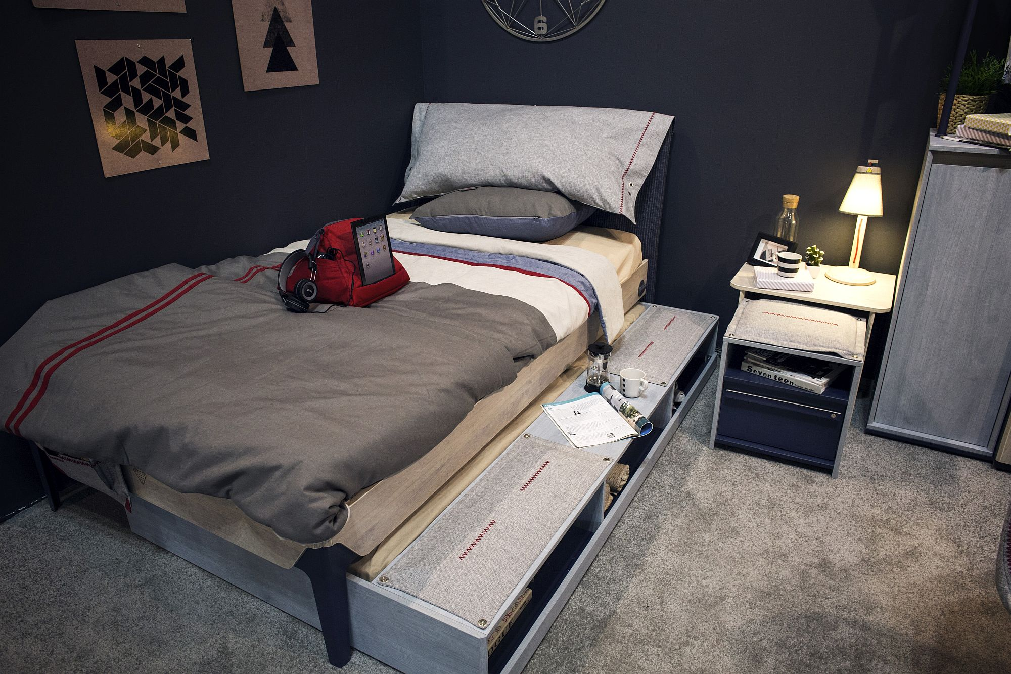 Space-savvy kids' bed with storage space underneath