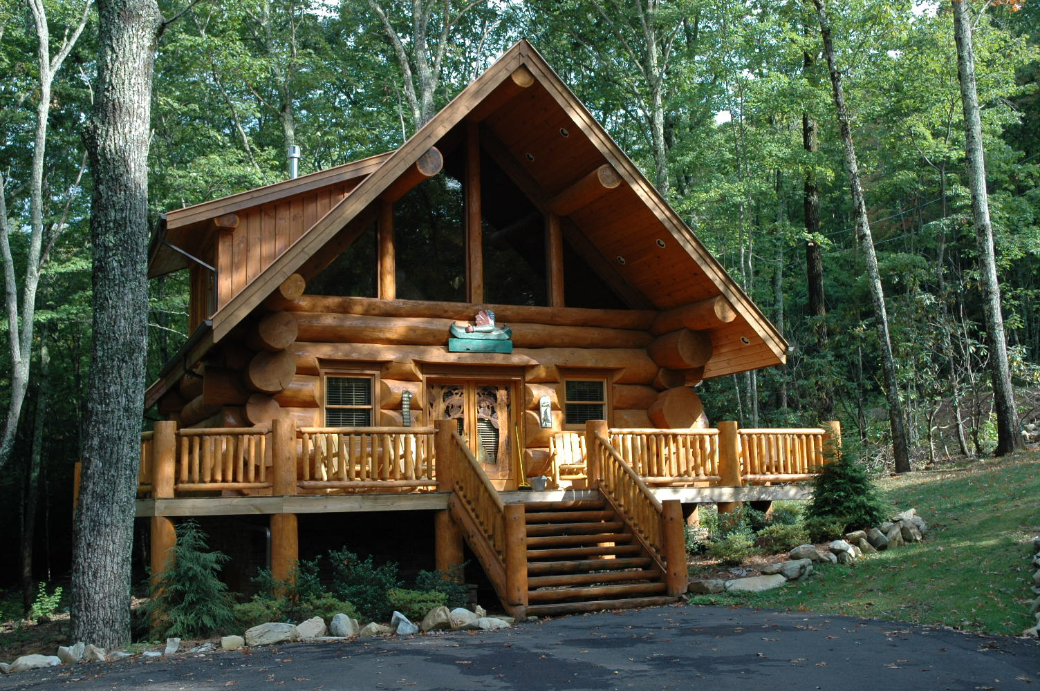 30 magical wood cabins to inspire your next off the grid vacay for Large cabin kits