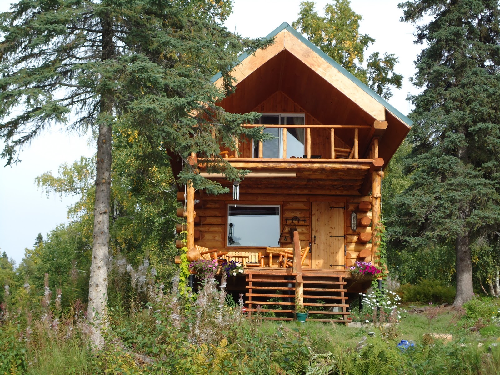 30 magical wood cabins to inspire your next off the grid vacay for Alaska log home builders