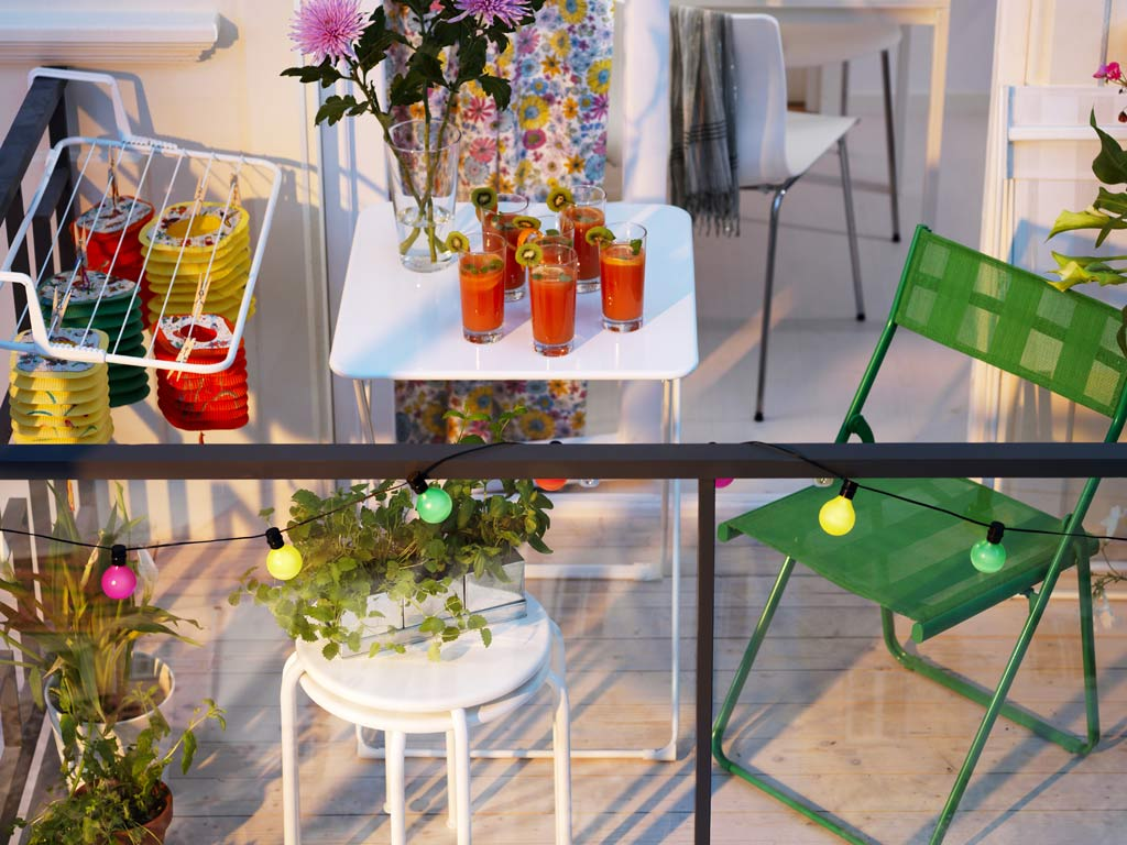 Tiny balcony with colorful string lights
