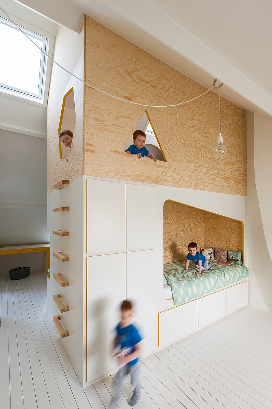 Twin niches for the beds on either side offer ample sleeping space Bespoke Brilliance: Twin Bed Wall in Kids' Room with Loft Play Zone