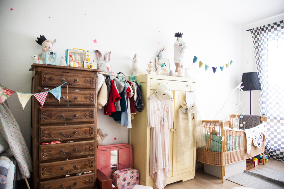 Vintage kids room with contrasting wooden cupboards