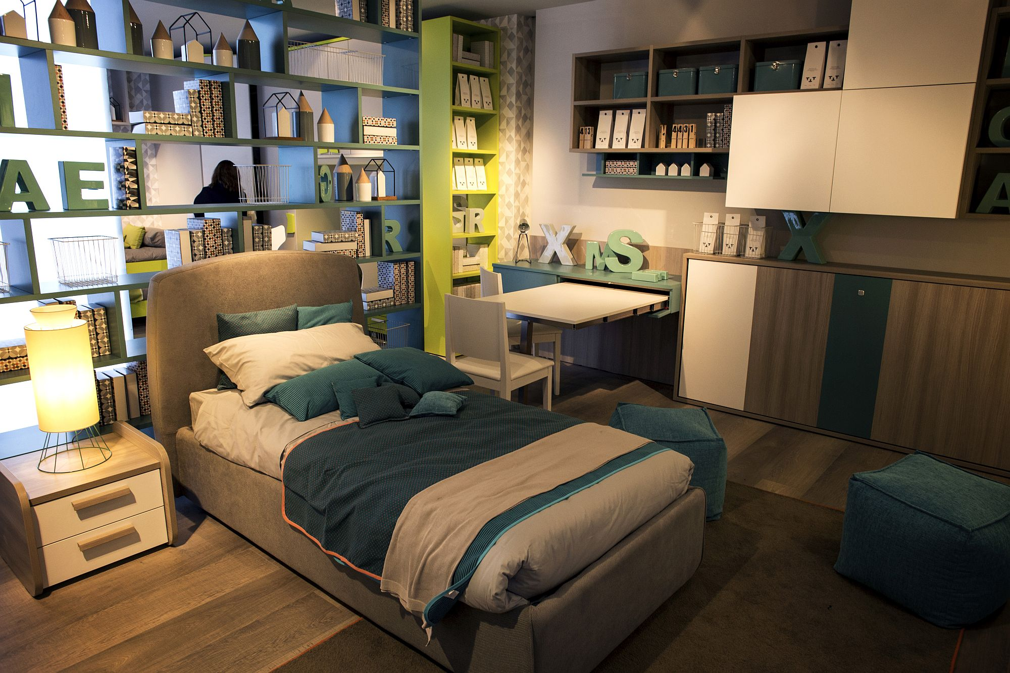 Wall of open shelves helps delineate space in style
