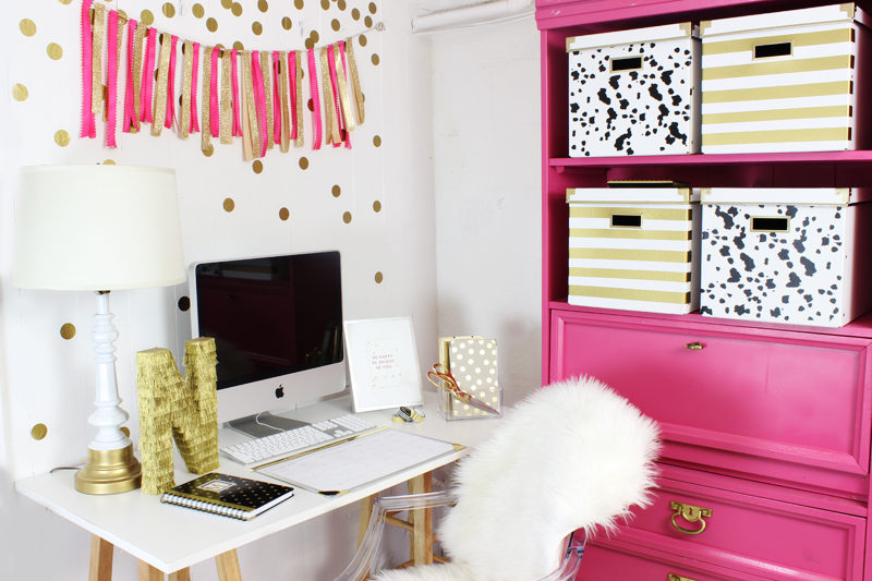 White and gold home office with bright pink elements