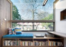 Window-seat-with-built-in-storage-for-a-large-book-collection-217x155