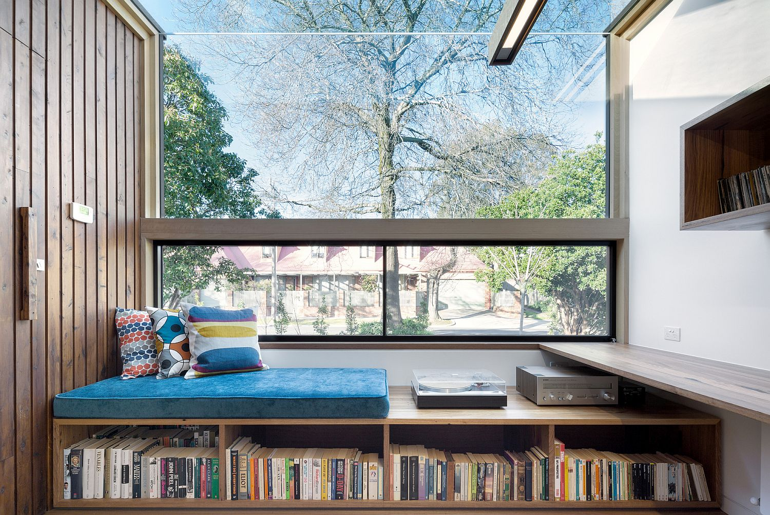 Window seat with built-in storage for a large book collection