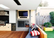 Wooden deck with barbecue and sitting area 217x155 Brighton Bunker: This Plywood Clad Poolside Hangout Does it All!