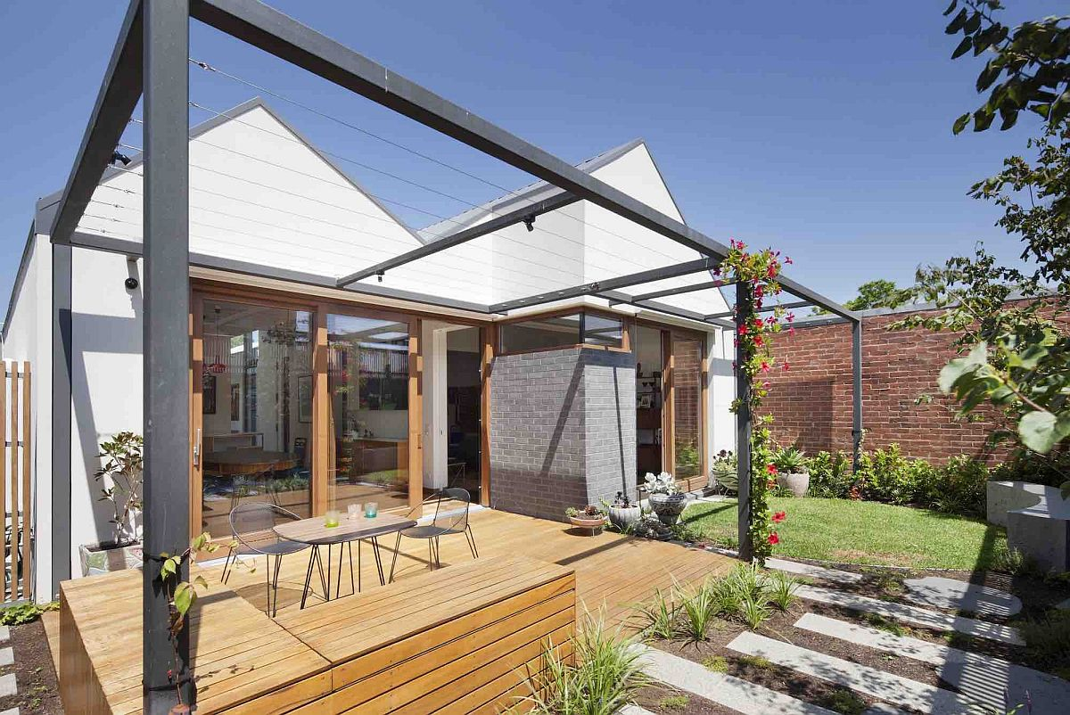 Wooden deck with pergola frame around it