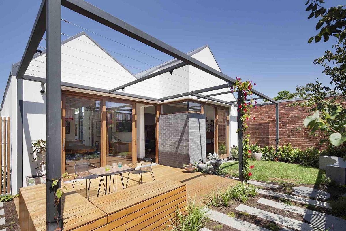 Wooden-deck-with-pergola-frame-around-it