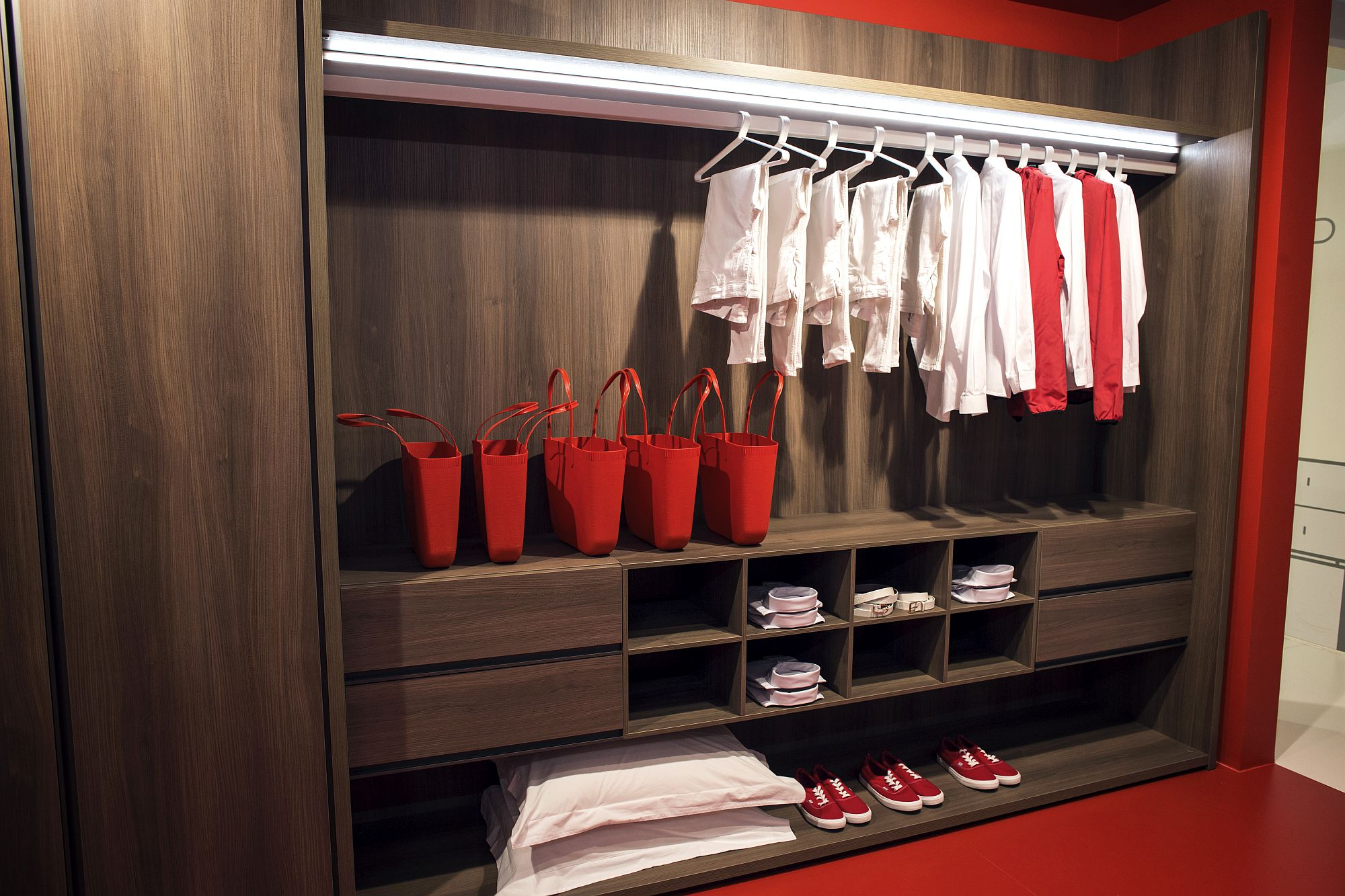 Wooden shelves and cabinets ample space for clothes and accessories
