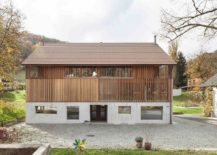 Wooden-slats-and-tiled-roof-give-the-converted-barn-a-classic-appeal-217x155