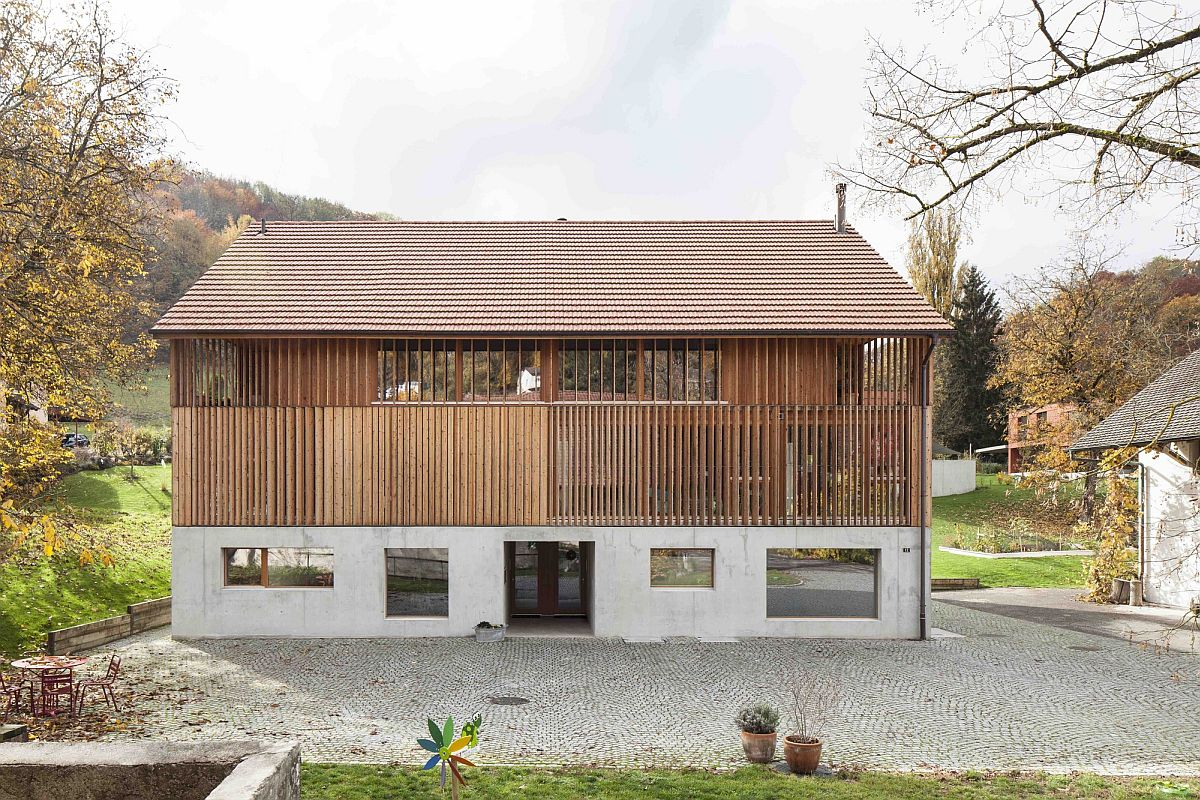 Wooden slats and tiled roof give the converted barn a classic appeal