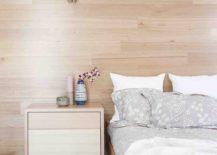 Wooden-walls-give-the-bedroom-a-cozy-Scandinavian-look-217x155