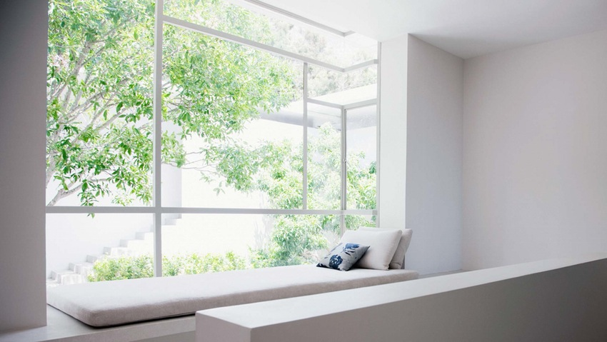 A-basic-white-room-with-a-big-window-seat