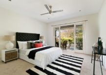A-bright-and-open-bedroom-with-a-monochrome-striped-rug-217x155