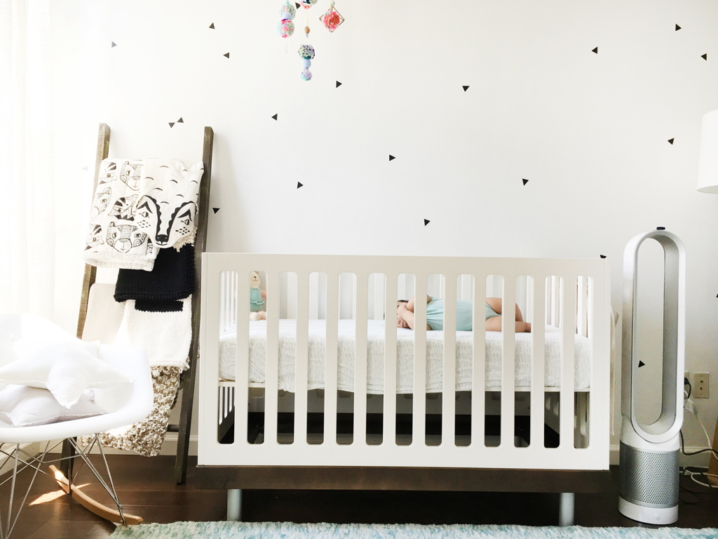 A bright monochrome nursery that feels soft and peaceful