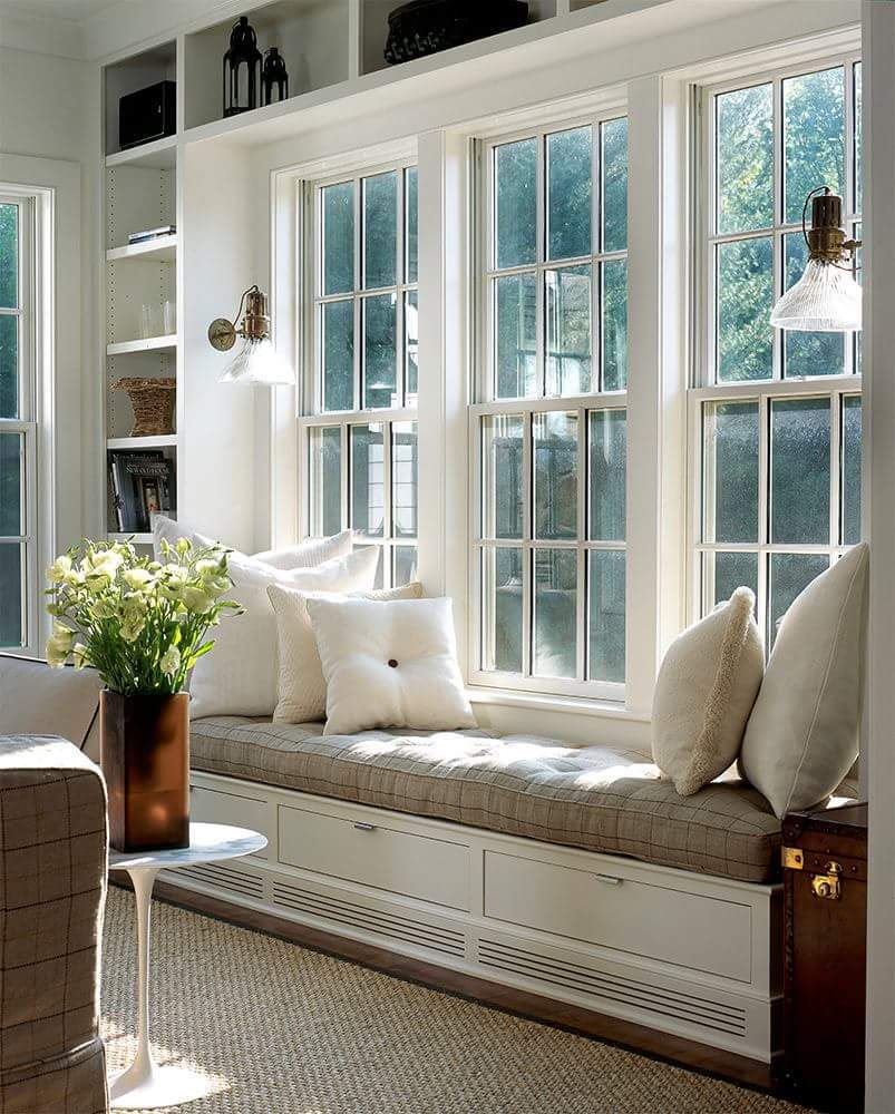 A charming window seat with a traditional look